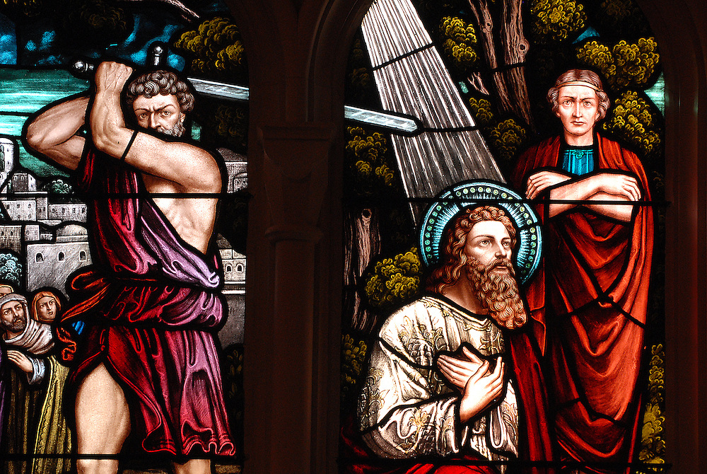 Stained glass image depicts beheading of St. Paul. (Sam Lucero photo)