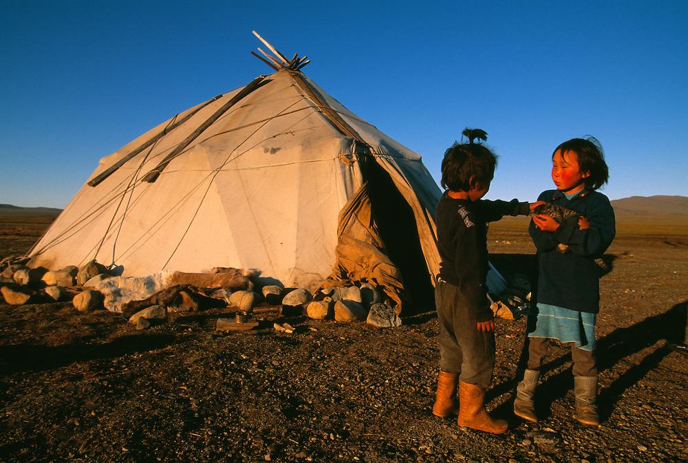 Chukchi kids in front of their traditional Yaranga tent, Chukotka, Siberia, Russia, Arctic