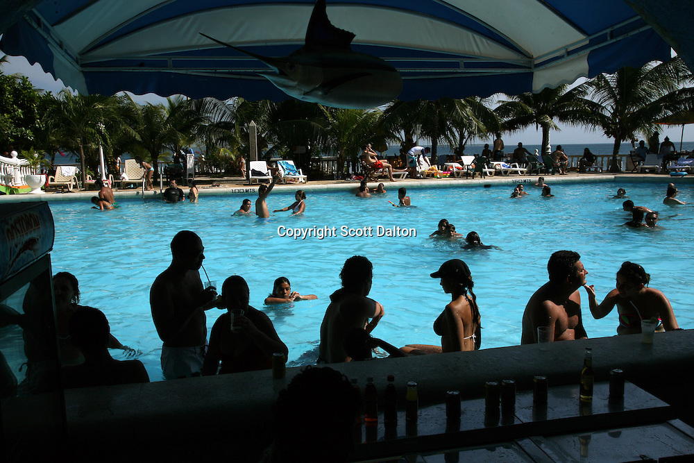 Tourists enjoy the pool at a resort in Isla Grande, one of the islands in an archipelago known as Islas del Rosario, about 35km southwest of Cartagena, on Colombia's Caribbean coast on January 2, 2009. (Photo/Scott Dalton)