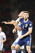 Scotland defender Stephen O?Donnell (2) (Kilmarnock) and Artem Dzyuba of Russia (22) (Zenit St Petersburg) during the UEFA European 2020 Qualifier match between Scotland and Russia at Hampden Park, Glasgow, United Kingdom on 6 September 2019.