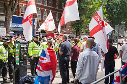 "Cricklewood, London, July 19th 2014. A handful of protesters from the anti-Islamist ""South East Alliance"" protest outside the London office of Egypt's Muslim Brotherhood, as large numbers of police keep them and counter-protesting anti-fascists separate."