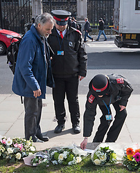 © Licensed to London News Pictures. 22/03/2018. London, UK. Floral Tributes left outside the Houses of Parliament in Westminster, London on the one year anniversary of the Westminster Bridge Terror attack in which lone terrorist killed 5 people and injured several more, in an attack using a car and a knife. The attacker, 52-year-old Briton Khalid Masood, managed to gain entry to the grounds of the Houses of Parliament and killed police officer Keith Palmer. Photo credit: Ben Cawthra/LNP