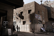 Egypt, Cairo: People walk past a church in   Moqattam, the christian coptic quarter in Cairo where live 40.000 Zabbaleen (garbage collectors). ph.Christian Minelli.