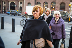 © Licensed to London News Pictures. 17/01/2017. London, UK. Suzy Evans, mother of terror attack survivor Owen Richards (not pictured) arriving at The Royal Courts of Justice for the second day of an inquest into the death of 30 Brits in the Tunisia terror attack. The attack took place is Sousse, Tunisia, when Seifeddine Rezgui killed 38 tourists on a beach outside Imperial Marhaba hotel. Photo credit : Tom Nicholson/LNP