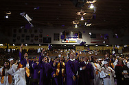 Some brand new graduates celebrate by tossing their caps during the Vandalia-Butler High School commencement at the BHS Student Activity Center in Vandalia, Friday, June 3, 2011.