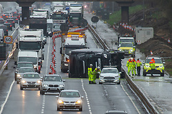 © Licensed to London News Pictures. 09/02/2020. Milton Keynes, UK. Strong winds brought about by Winter Storm Ciara have caused a lorry to blow over on the M1 carriageway Southbound between Junction 15 and Junction 14 in Milton Keynes. Photo credit: Peter Manning/LNP