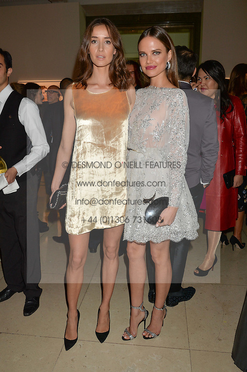 Left to right, REKHA LUTHER and ALICIA ROUNTREE at the De Beers Moments in Light - a celebration of telented women in association with Women For Women International featuring photographs by Mary McCartney held at Claridge's, Brook Street, London on 18th September 2015.