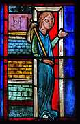 Mary of Egypt leaving her home in Alexandria before her journey to Jerusalem, from the stained glass window of St Mary of Egypt, 1215-25, in bay 21, in the ambulatory of Bourges Cathedral or the Cathedrale Saint-Etienne de Bourges, built 1195-1230 in French Gothic style and consecrated in 1324, in Bourges, Centre-Val de Loire, France. 22 of the original 25 medieval stained glass windows of the ambulatory have survived. The cathedral is listed as a UNESCO World Heritage Site. Picture by Manuel Cohen