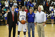 "Logan Terrell with the three men who have coached him through is high school career, (l to r) Ben Breeden, Tim Taylor, and Phil Warren, after receiving the game ball during a brief ceremony after he broke Madison's all time career scoring record.  MCHS Varsity Boys Basketball .vs Luray Bulldogs.The Boys Varsity Basketball team beat Luray tonight 77-64 to improve to 8-0 on the season. Logan Terrell led the Mountaineers with 20 points and also became the schools all time scoring leader during the 1st quarter tonight. Logan passed James ""Sleepy"" Johnson who set the record in 1975 with 1,379 points. Logan finished the night with 1,392 points. Jerel Carter finished with 16 points, David Falk 15 points and A.J. Butler added 12 points to help seal the win..12/30/09"