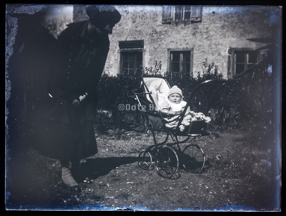 mother with baby in pram France 1921