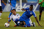 San Jose Earthquakes midfielder Marvin Chavez (81) tackles Montreal Impact midfielder Davy Arnaud (22) during the first half of play at Buck Shaw Stadium in Santa Clara, California, on September 17, 2013. (Stan Olszewski/QMI Agency)