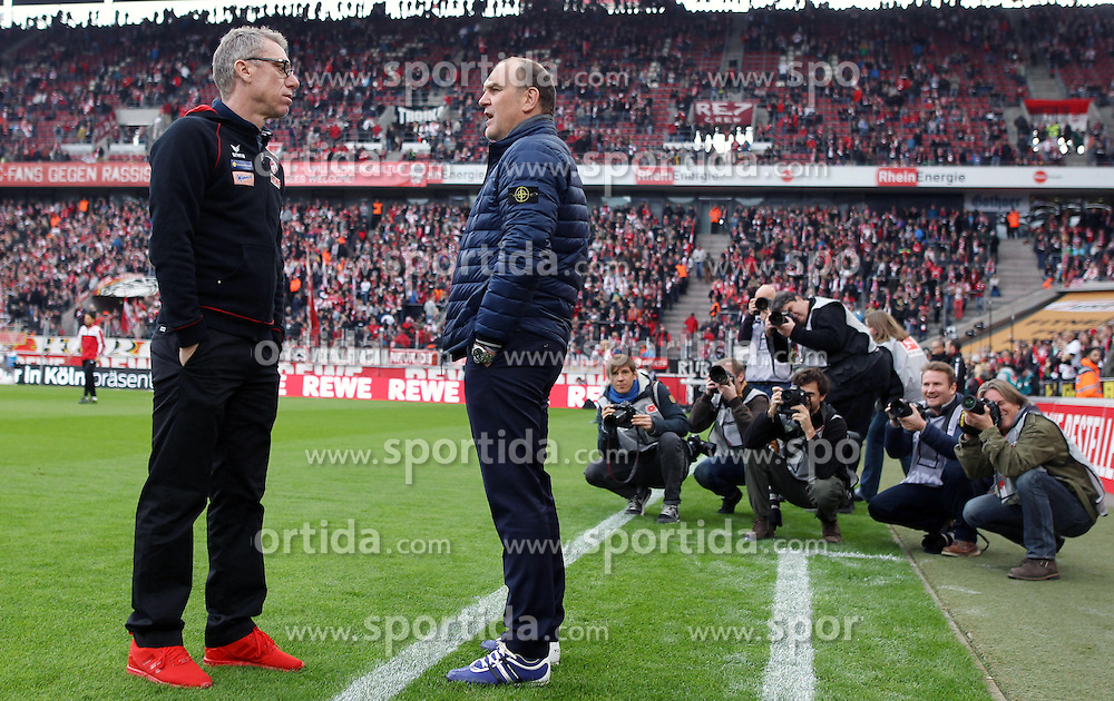 18.10.2015, Rhein Energie Stadion, Koeln, GER, 1. FBL, 1. FC Koeln vs Hannover 96, 9. Runde, im Bild Sportlicher Leiter, Manager Joerg Schmadtke (1. FC Koeln) im Gespraech mit Trainer Peter Stoeger (1. FC Koeln) mit Fotografen im Hintergrund // during the German Bundesliga 9th round match between 1. FC Cologne and Hannover 96 at the Rhein Energie Stadion in Koeln, Germany on 2015/10/18. EXPA Pictures &copy; 2015, PhotoCredit: EXPA/ Eibner-Pressefoto/ Schueler<br /> <br /> *****ATTENTION - OUT of GER*****