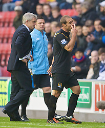 WIGAN, ENGLAND - Sunday, October 18, 2009: Manchester City's Pablo Zabaleta protests his innocence after being shown a red card and sent off during the Premiership match against Wigan Athletic at the JJB Stadium. (Pic by David Rawcliffe/Propaganda)