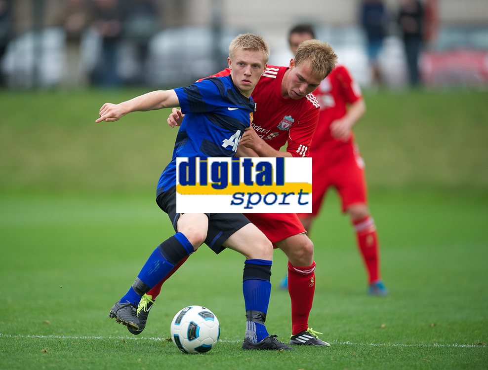 LIVERPOOL, ENGLAND - Friday, October 14, 2011: Liverpool's Tom King in action against Manchester United's Mats Daehli during the FA Premier League Academy match at the Kirkby Academy. (Pic by David Rawcliffe/Propaganda)