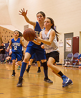 Gilford's Maura Hughes and Belmont's Savannah Perkins  on the court during the Senior Girls game of the 23rd annual Francoeur Babcock Memorial Basketball Tournament on Saturday afternoon. (Karen Bobotas/for the Laconia Daily Sun)