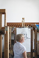 Mature woman in art studio smiling