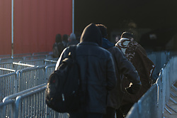 October 25, 2016 - Calais, France - Minor migrants walk the closures towards the registration center in the jungle of Calais  in Calais, France, on 25 October 2016. Up to the evening, about 4,000 migrants from the Refugee camp on the coast at the English Channel were distributed to several regions in France. The police have begun to tear down the huts and tents in the camp. (Credit Image: © Markus Heine/NurPhoto via ZUMA Press)