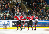 KELOWNA, CANADA - OCTOBER 10: Dylen McKinlay #19, Mitchell Wheaton #6, Myles Bell #29 and Colton Sissons #15 of the Kelowna Rockets celebrate a goal against the Spokane Chiefs  at the Kelowna Rockets on October 10, 2012 at Prospera Place in Kelowna, British Columbia, Canada (Photo by Marissa Baecker/Shoot the Breeze) *** Local Caption ***