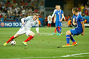 England Forward Wayne Rooney looks to find a shooting position during the Round of 16 Euro 2016 match between England and Iceland at Stade de Nice, Nice, France on 27 June 2016. Photo by Andy Walter.
