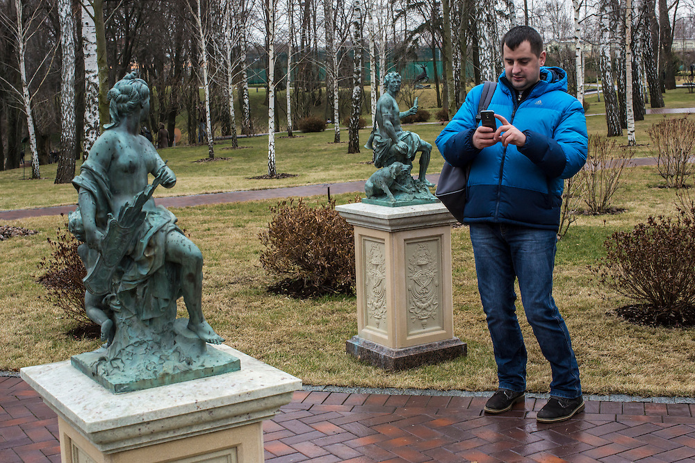 KIEV, UKRAINE - FEBRUARY 22: A man photographs statues at President Viktor Yanukovych's Mezhyhirya estate, which was abandoned by security, on February 22, 2014 in Kiev, Ukraine. After a chaotic and violent week, protesters took control of Kiev as President Viktor Yanukovych fled the city amid calls for his immediate resignation. (Photo by Brendan Hoffman/Getty Images) *** Local Caption ***