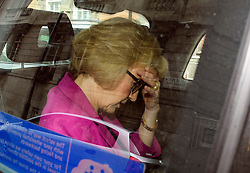 © Licensed to London News Pictures. 11/07/2016. London, UK. ANDREA LEADSOM MP with her head in her hands as while in a back cab after delivering a statement in Westminster on July 11, 2016 in which she stood down from the conservative party leadership race.  Photo credit: Ben Cawthra/LNP