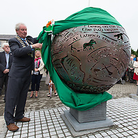 Cllr James Breen,Cathaoirleach of Clare County Council, Unveiling 'The Centurial Sphere' sculpted by Kilkee blacksmith Paddy Murray.