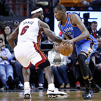 16 March 2011: Oklahoma City Thunder small forward Kevin Durant (35) drives past Miami Heat small forward LeBron James (6) during the Oklahoma City Thunder 96-85 victory over the Miami Heat at the AmericanAirlines Arena, Miami, Florida, USA.