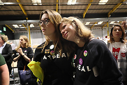 Repeal supporters at Dublin's RDS wait for the start of the count in the referendum on the 8th Amendment of the Irish Constitution which prohibits abortions unless a mother's life is in danger.