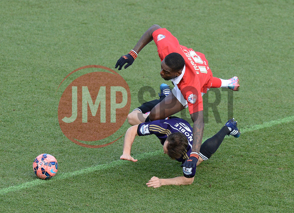 West Ham's Mark Noble fouls Bristol City's Jay Emmanuel-Thomas - Photo mandatory by-line: Alex James/JMP - Mobile: 07966 386802 - 25/01/2015 - SPORT - Football - Bristol - Ashton Gate - Bristol City v West Ham United - FA Cup Fourth Round