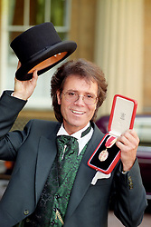File photo dated 25/10/1995 of singer Cliff Richard, who has won his legal action against the BBC over coverage of a police raid at his apartment in Berkshire in August 2014, at Buckingham Palace after he was knighted by Queen Elizabeth II.