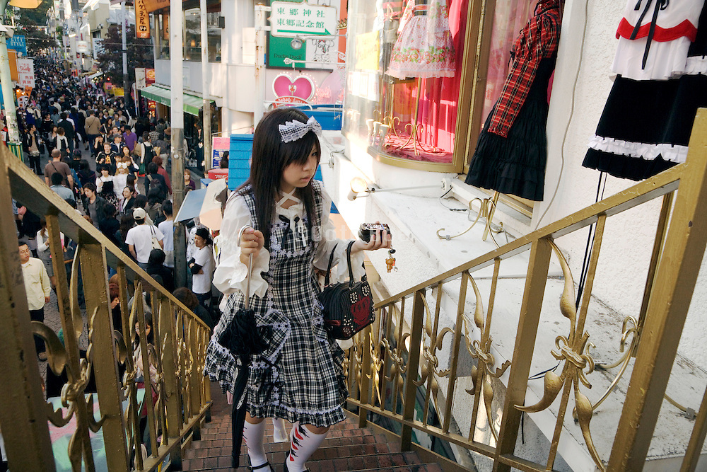 young girl fully dressed up going upstairs to a Lolita store