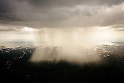 An isolated cloudburst over Gulf Coast wetlands illustrates the link between land and atmosphere. Wetlands have large evaportative surfaces that are an important part of the water cycle. They absorb rainwater runoff and filter out sediments, metals, and pollutants.