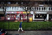 London | 09 Apr 2010<br /> <br /> Store fronts (Oscar's Den) and pedestrian in the rain, 127-129, Abbey Road.<br /> <br /> &copy;peter-juelich.com<br /> <br /> [No Model Release | No Property Release]