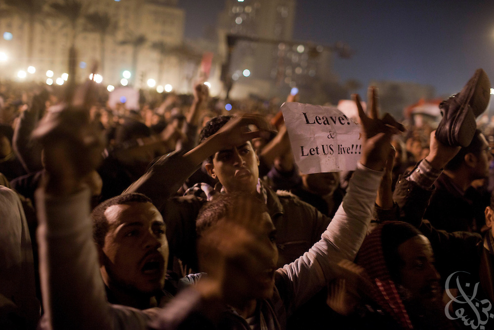 "Egyptian protesters react chant anti-Mubarak slogans and wave shoes  as a sign of both disrespect and dissatisfaction after watching a live televised speech by President Hosni Mubarak February 01, 2011 in Central Cairo's Tahrir, or ""Liberation"" square. Mubarak announced he would not seek re-election in elections later this year and would immediately enact reforms in the constitution."