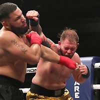 TAMPA, FL - JUNE 22: Jared Hayes lands a punch to the face of Chris Boffil during the Bare Knuckle Fighting Championships at Florida State Fairgrounds Entertainment Hall on June 22, 2019 in Tampa, Florida. (Photo by Alex Menendez/Getty Images) *** Local Caption *** Jared Hayes; Chris Boffil