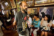SAN SEBASTIAN - SPAIN - 23 JULY 2010 -- A man selling lotto coupons passes locals and tourists eating tapas, or in Basques called pintxos, for lunch time at the Casa Alcalde Tapas Bar, San Sebastian. PHOTO: ERIK LUNTANG / INSPIRIT Photo.