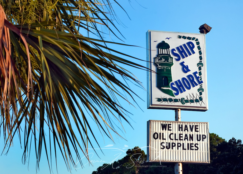 A sign advertises oil cleanup supplies for sale at Ship & Shore in Dauphin Island, Ala. Oil continues to spill into the Gulf of Mexico following the April 20, 2010 explosion of the Deepwater Horizon oil rig, fouling marshes and beaches along the Louisiana, Mississippi, Alabama, and Florida coastline. Tar balls have been found on Dauphin Island beaches, but so far the area has avoided more serious consequences. (Photo by Carmen K. Sisson/Cloudybright)