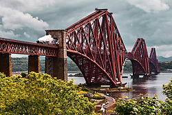 Pictured: The famous Flying Scotsman Steam Train crosses the iconic Forth Rail Bridge earlier today as part of a tour of Fife and Stirling. The engine No 60103 first saw service in 1948 and crossed the Bridge that opened in 1889.  Andrew West/ EEm
