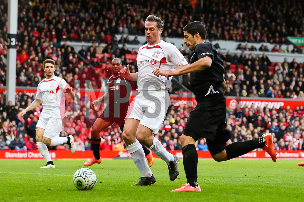 Luis Suarez is closed down by Jamie Carragher - Photo mandatory by-line: Dougie Allward/JMP - Mobile: 07966 386802 - 29/03/2015 - SPORT - Football - Liverpool - Anfield Stadium - Gerrard's Squad v Carragher's Squad - Liverpool FC All stars Game