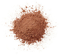 MAC golden bronze powder pile on white background