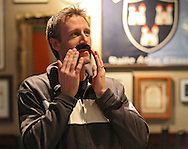 Nate Holler, of Cedar Rapids, applies his adhesive mustache at a Movember get together during the Iowa football game at Dublin City Pub in Cedar Rapids on Saturday, November 17, 2012.