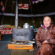 Portrait of a Dukha (Tsaatan) woman in her ortz (teepee). Approximately 200 families comprise the Tsaatan or Dukha community in northwestern Mongolia, whose existence is intimately linked to their herds of reindeer. Photo © Robert van Sluis