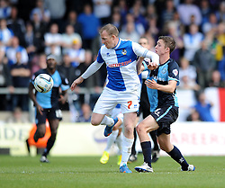 Bristol Rovers' David Clarkson keeps the ball away from Wycombe Wanderers' Dan Rowe - Photo mandatory by-line: Dougie Allward/JMP - Mobile: 07966 386802 26/04/2014 - SPORT - FOOTBALL - High Wycombe - Adams Park - Wycombe Wanderers v Bristol Rovers - Sky Bet League Two
