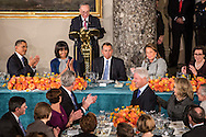 Former President Bill Clinton gets a round of applause at the Inaugural Luncheon hosted for President Barack Obama in Statuary Hall in the U.S. Capitol on Monday, January 21, 2013 in Washington, DC.