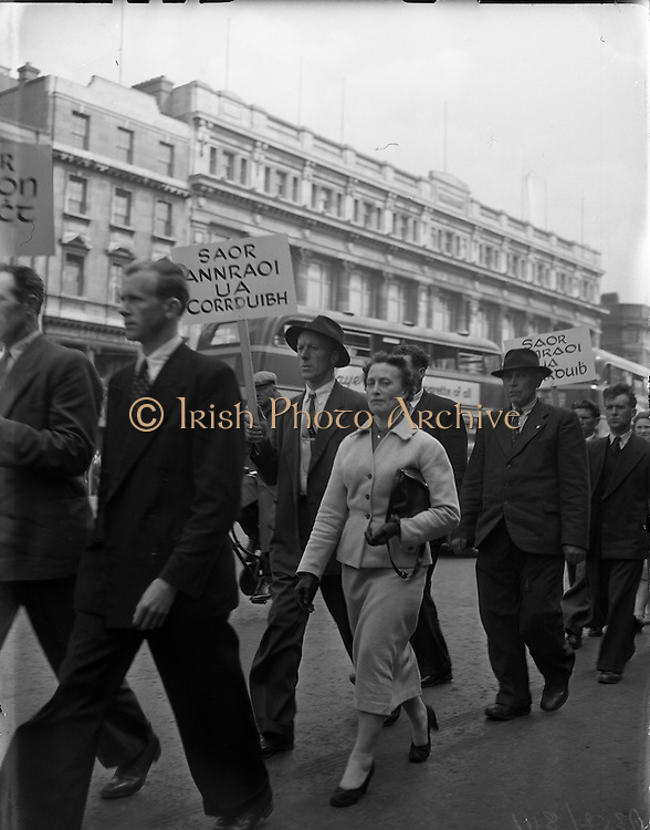 Thanks so much to Treasa Ní Ghearraigh for sending an email expanding on the captions for the Harry Corduff images!  She informs us that the picture shows a march in Dublin following the jailing of Anraoi Ó Corrduibh (Harry Corduff), then Principal of Rossport National School, who took a stand against the deplorable condition of local roads and refused to pay his road tax in an effort to highlight the situation.  Holding up the placard at the front is P.J. Ó Gearbháin, a local shopkeeper from Ceathrú Thaidhg who himself was also jailed, and Bríd Uí Chorrduibh (Harry's wife).  Directly behind Bríd is Cathaoir Ó Dochartaigh from Ceathrú Thaidhg.<br /> <br /> Gaeltacht protest for Harry Corduff in Mountjoy 25/04/1957