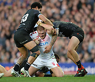 Thomas Burgess of England is tackled by Adam Blair (L) &amp; Kevin Proctor (R) of New Zealand during the Autumn International Series match at Elland Road, Leeds<br /> Picture by Richard Land/Focus Images Ltd +44 7713 507003<br /> 11/11/2018