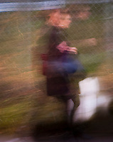 abstract ferry terminal commuters in motion blur at the Bainbridge Island, WA ferry terminal