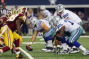 The Dallas Cowboys offense gets set opposite the Washington Redskins defense at the line of scrimmage during the NFL week 6 football game against the Washington Redskins on Sunday, Oct. 13, 2013 in Arlington, Texas. The Cowboys won the game 31-16. ©Paul Anthony Spinelli