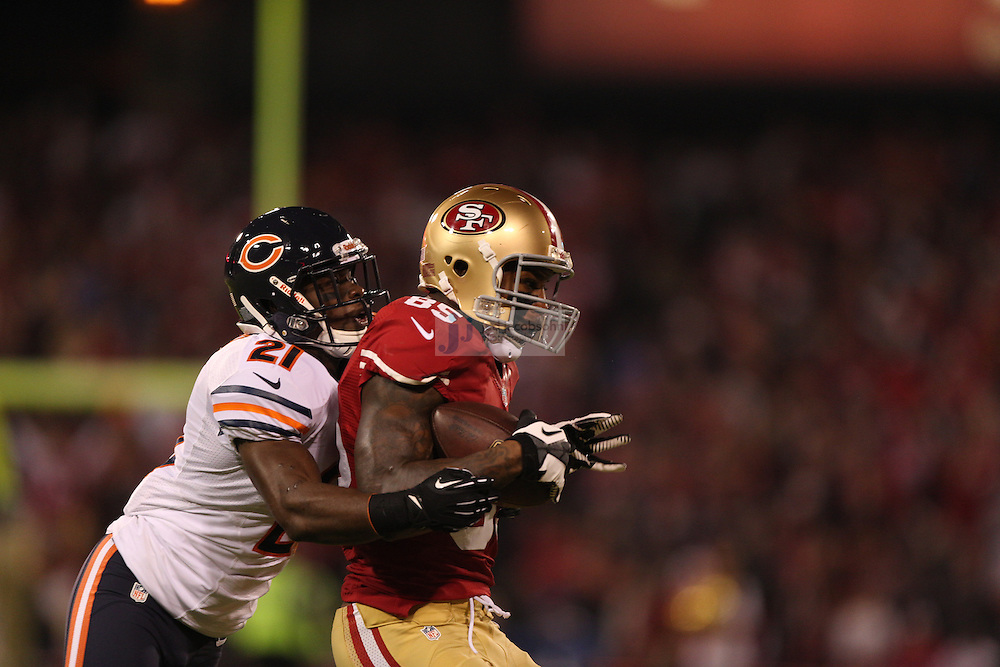 San Francisco 49ers tight end Vernon Davis (85) catches a pass over Chicago Bears safety Major Wright (21), during an NFL game on Monday Nov. 19, 2012 in San Francisco, CA.  (photo by Jed Jacobsohn)