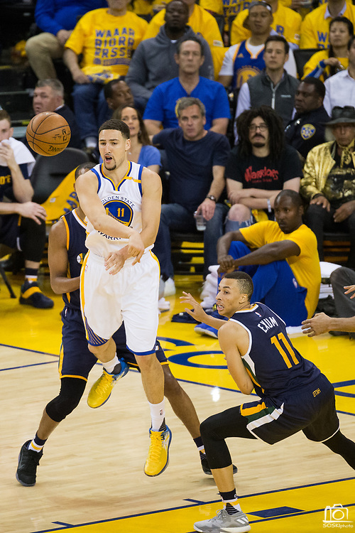 Golden State Warriors guard Klay Thompson (11) passes the ball against the Utah Jazz during Game 2 of the Western Conference Semifinals at Oracle Arena in Oakland, Calif., on May 4, 2017. (Stan Olszewski/Special to S.F. Examiner)